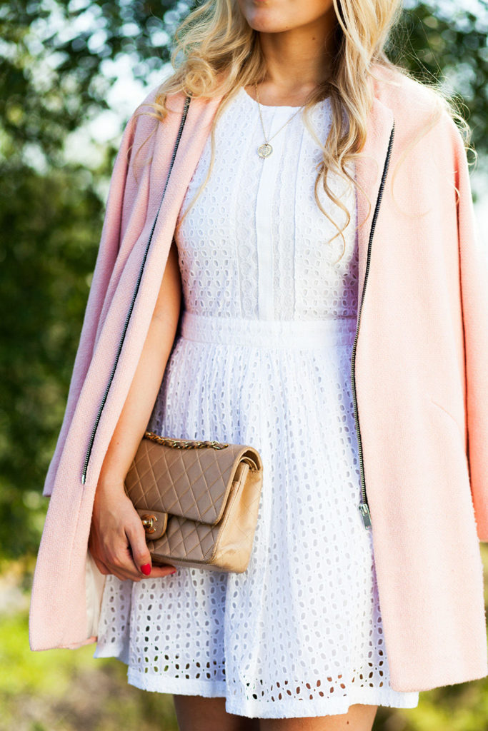 Cathrine Heienberg is wearing a white mesh dress from Vila Clothing, pink coat from Zara and the bag is from Chanel
