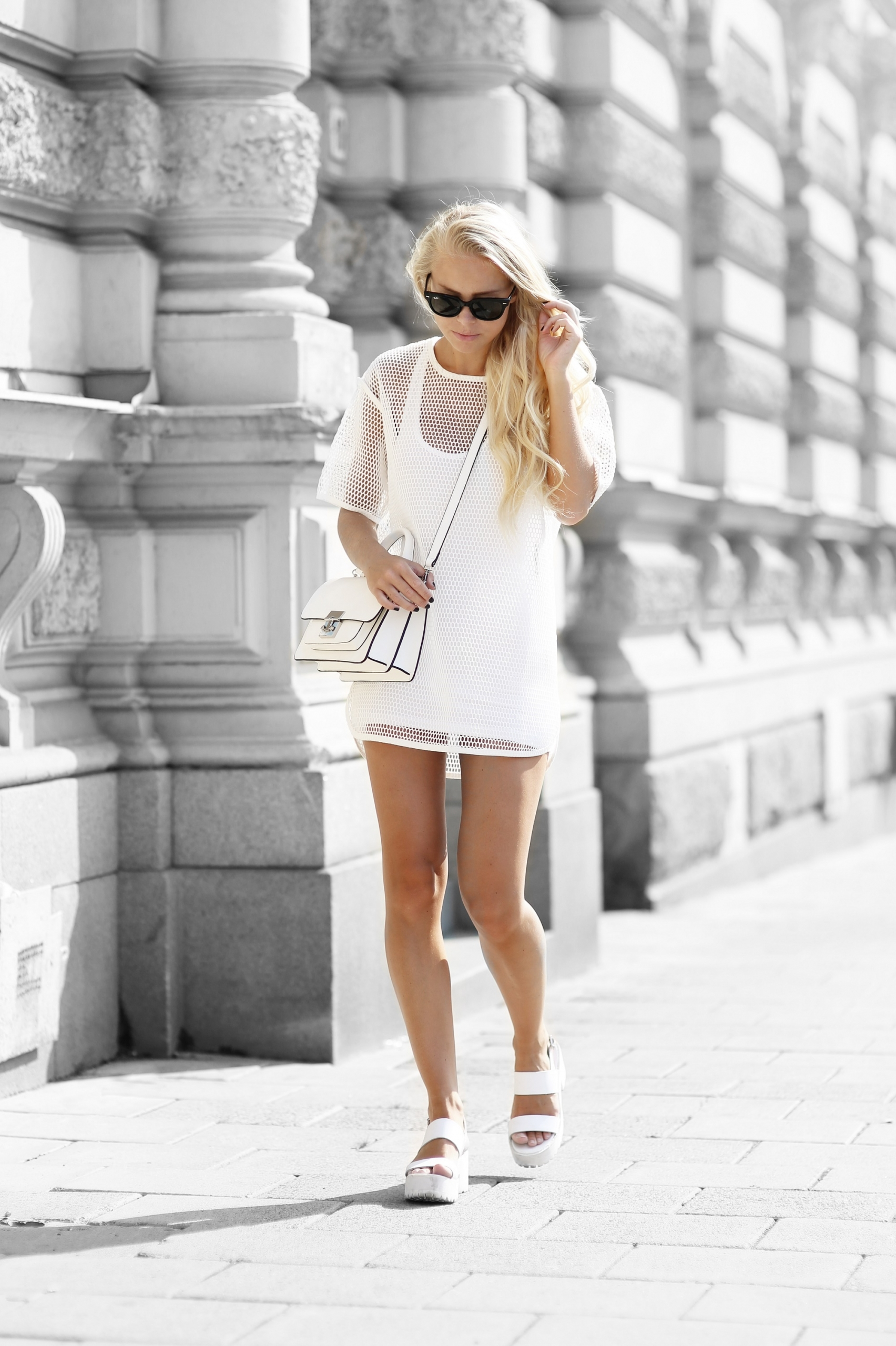 Victoria Tornegren is wearing shoes from River Island, white mesh dress from Front Row, bag from Zara and sunglasses from Ray Ban
