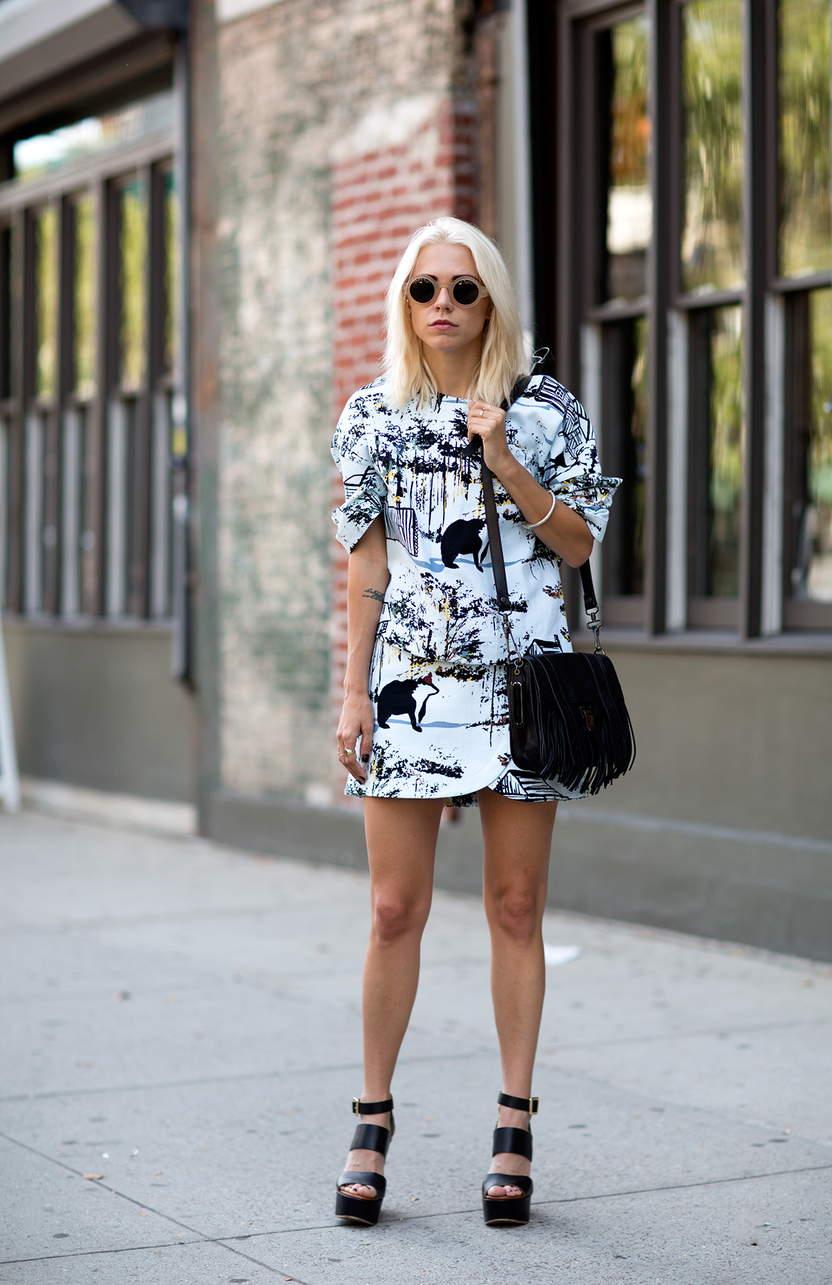 Courtney Trop is wearing matching printed top and skirt from Tibi, sunglasses from Manifesto, wedges from Chloe and the bag is from Proenza Schouler