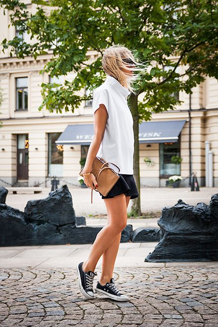 Charlotte Hellberg is wearing a white sweater from H&M, black skirt from Asos, bag from COS, sunglasses from Karen Walker and black Converse
