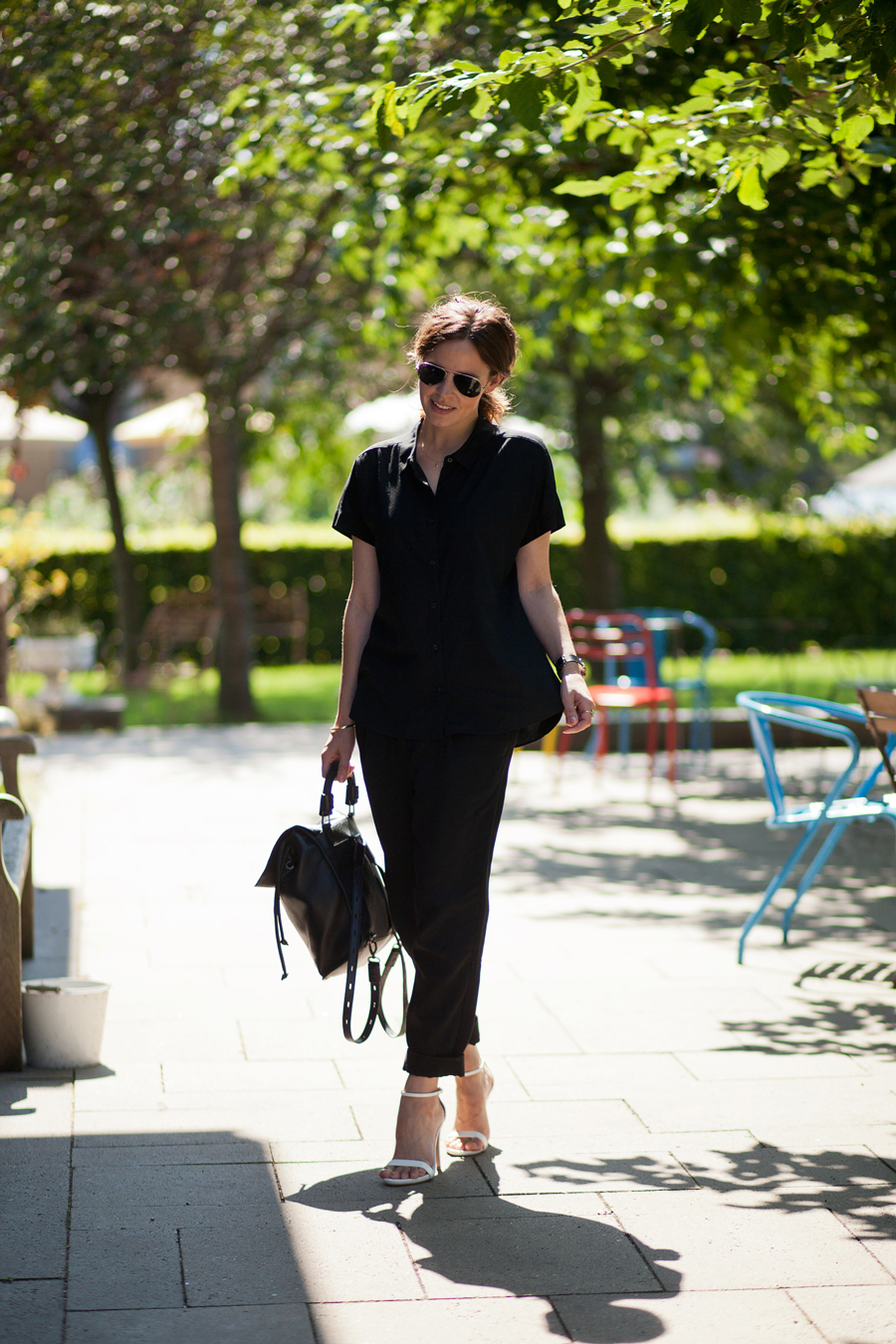 Christine Reehorst is wearing all black, shirt from Uniqlo, trousers fom H&M, shoes from Zara, backpack from TopShop and sunnies from RayBan