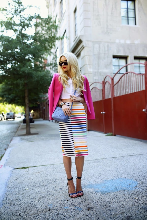 Blair Eadie is wearing a multi coloured striped skirt from Tanya Taylor, crop top from ASOS, pink jacket from Zara, shoes from Tibi, bag from Gucci and sunglasses from Karen Walker