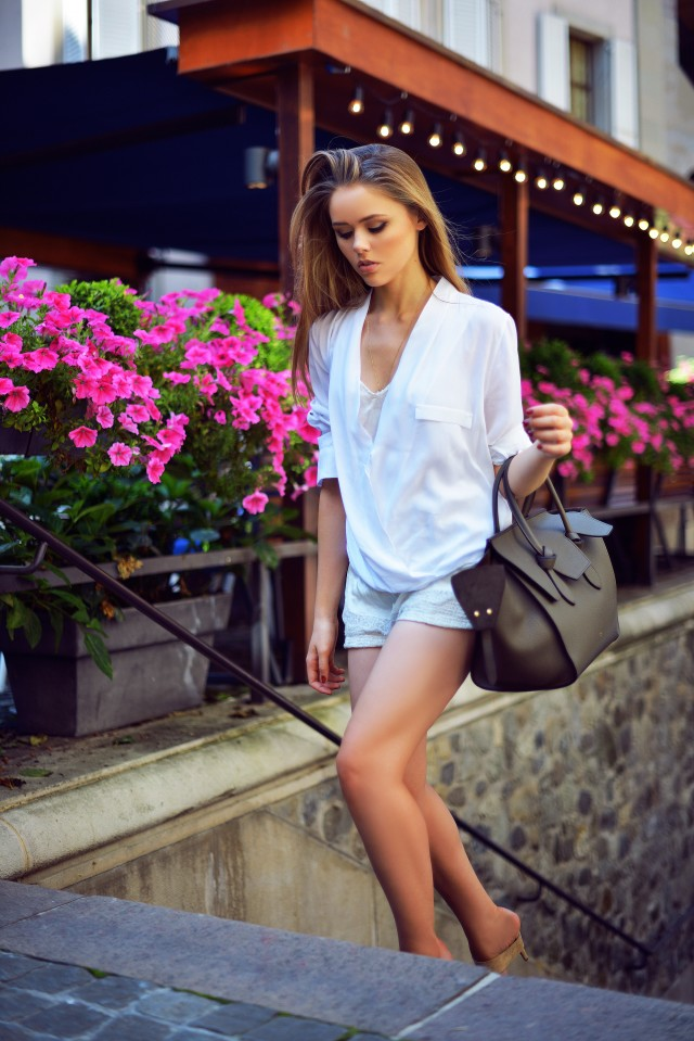 Kristina Bazan is wearing a top from Zara, shorts from Zara, shoes from Alexander Wang and a bag from Céline