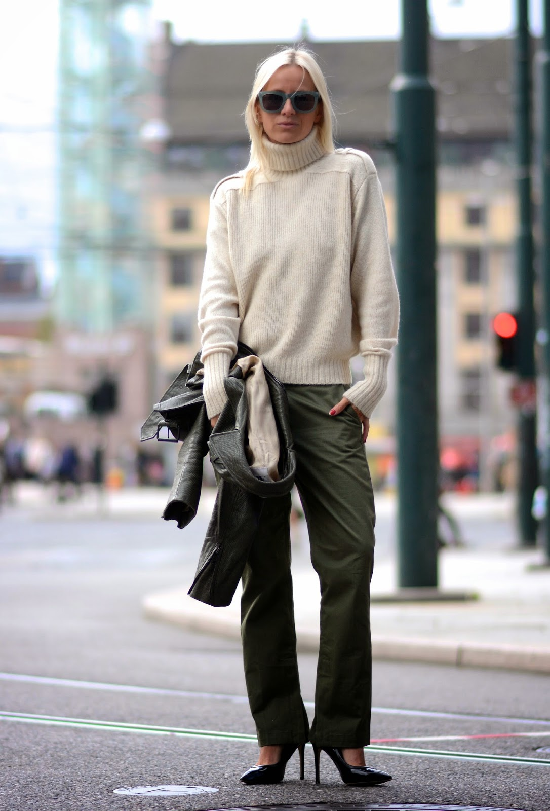 Celine Aagaard is wearing a white long sleeved turtleneck, army green trousers and pumps