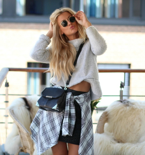 Lene Orvik is wearing a jumper from Zara, skirt from Never Denim, plaid shirt from BikBok and sunglasses from Rayban