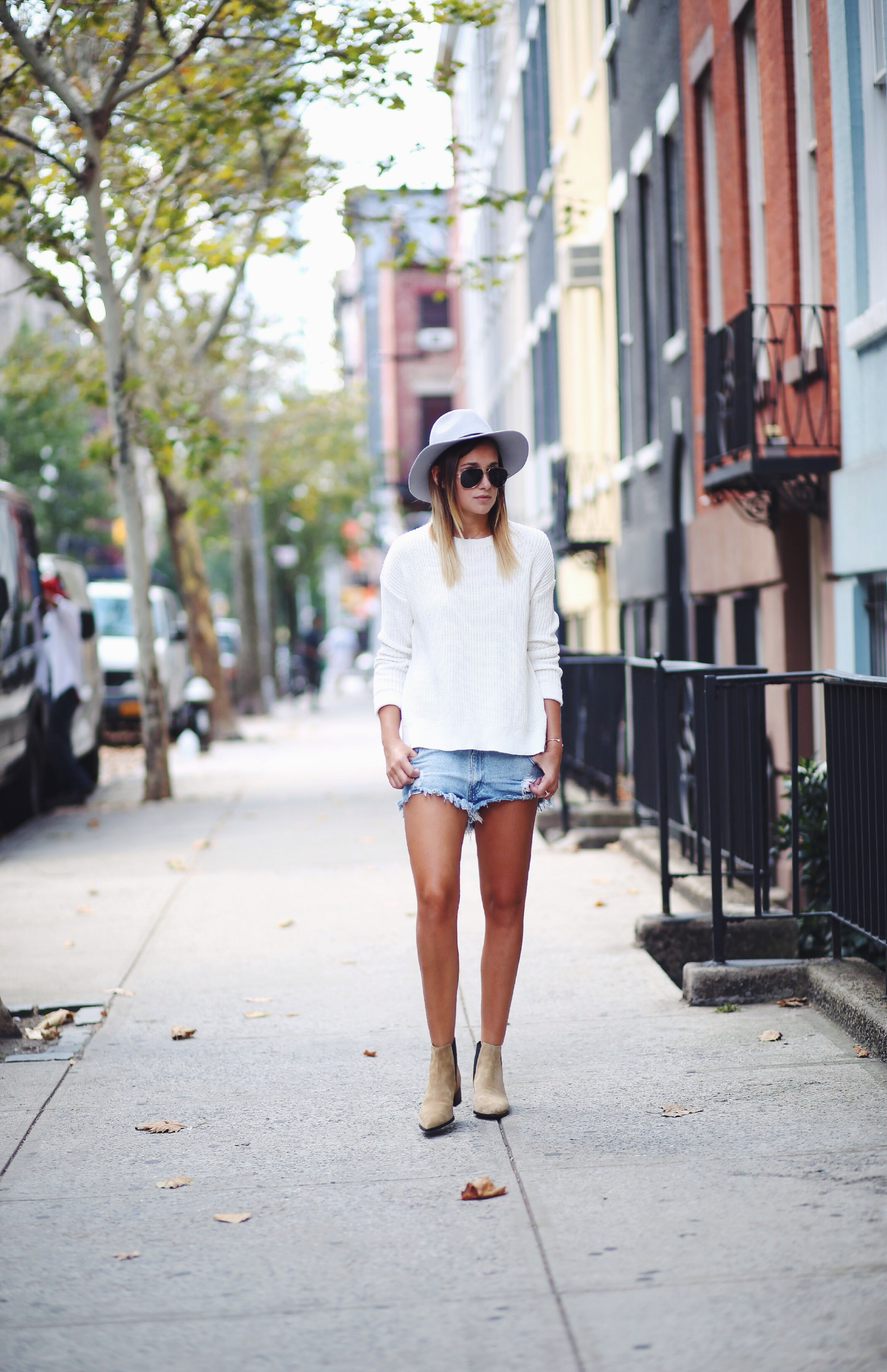 Danielle Bernstein is wearing a sweater from TopShop, denim shorts from One Teaspoonand boots from Acne