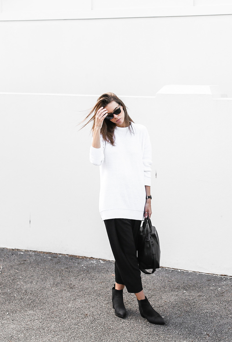 Kaitlyn Ham is wearing a sweater and boots from Acne Studios, trousers from Malene Birger and a bag from Alexander Wang