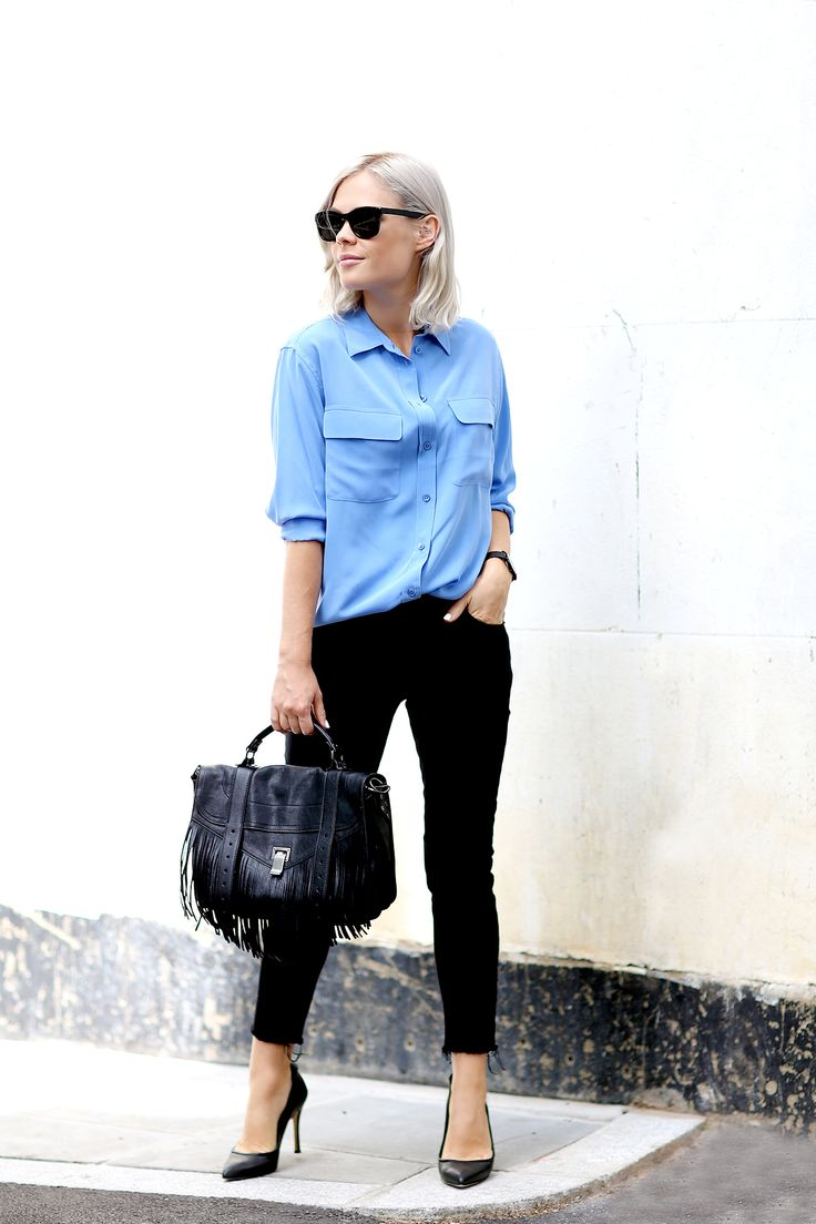 Jessie Bush is wearing a sunglasses from Nick Campbell, blue silk shirt from Equipment, black jeans from Black Monday, friendges satchel from Proenza Schouler and shoes from Yvonne Kone