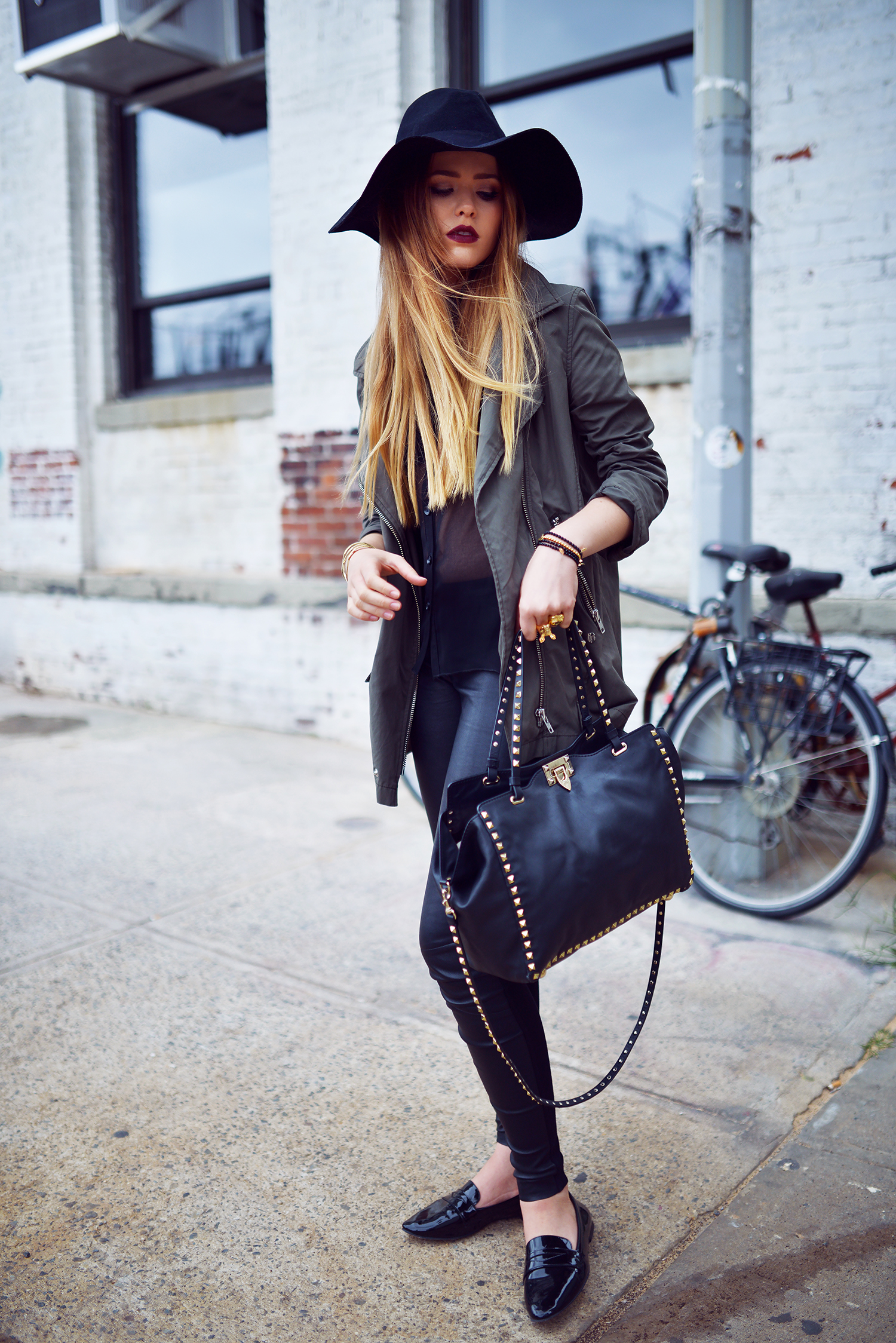 Kristina Bazan is wearing a top from Minusey, jacket from The Kooples, shoes from Zara, bag from Valentino, hat from H&M and trousers from Hugo Boss
