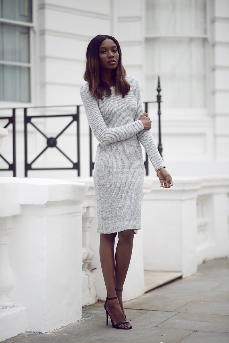 Natasha Ndlovu is wearing a grey knit top and skirt and shoes from MissGuided