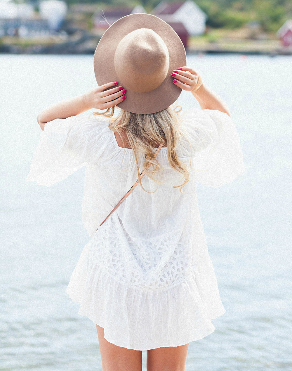 Cathrine Heienberg in a white summer dress and hat