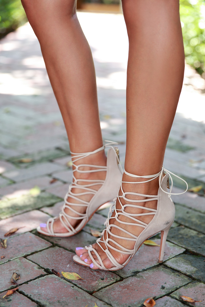 Annabelle Fleur is wearing a pair of nude lace up sandals from Schutz