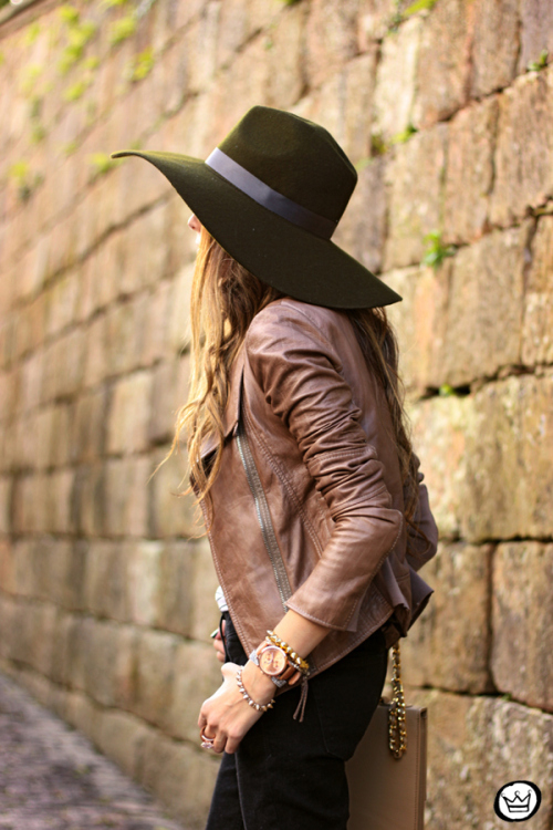 Flavia Desgranges is wearing a brown leather jacket from Boda Skins and a hat from Lack Of Color