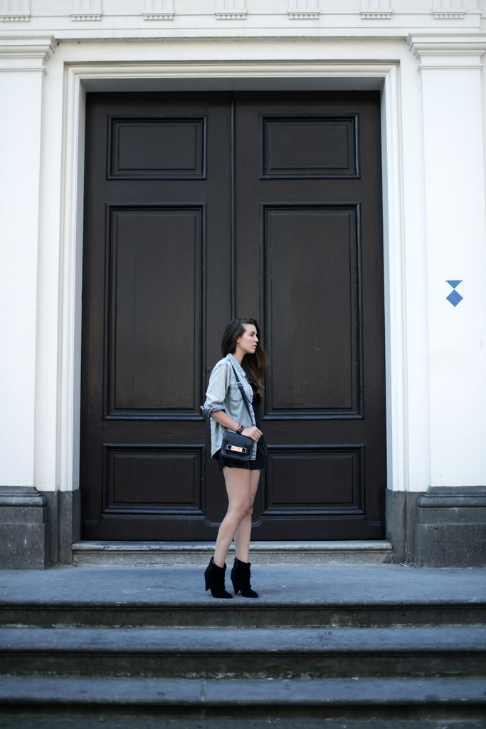 Cindy Van Der Heyden is wearing a boots from Isabel Marant, shorts from Stylestalker, denim blouse and a PS11 bag from Proenza Schouler