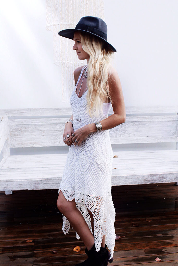 Helen Janneson is wearing a white chrochet dress from Chicwish