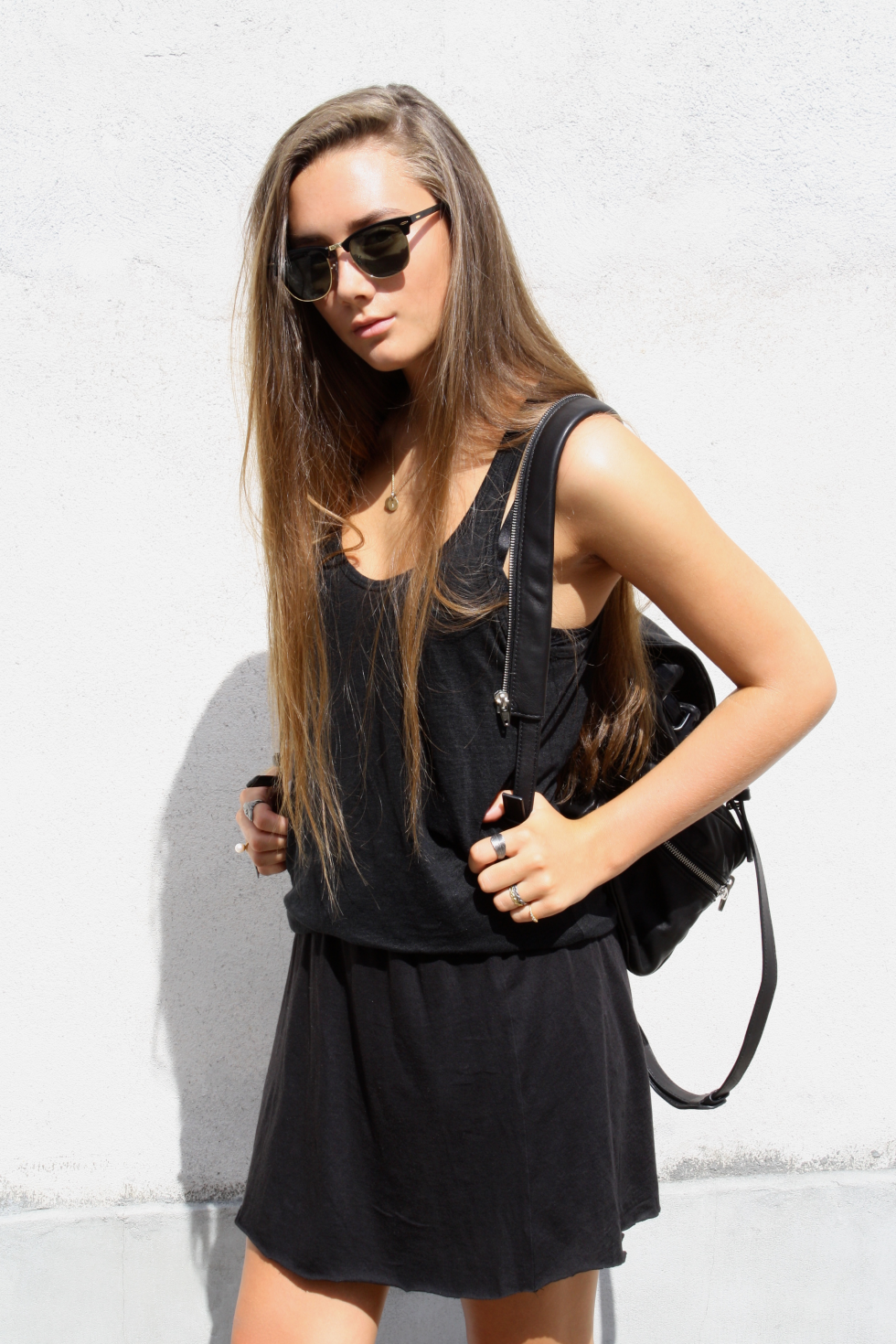 Cecilie Slemming is wearing all black, top from Zara, skirt from Gina Tricot, and backpack from Alexander Wang