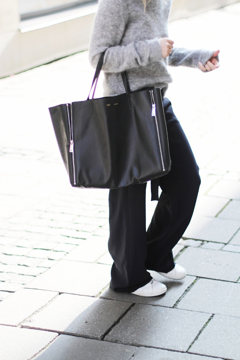 Mija is wearing a a grey mohair jumper from Acne Studios, black wide leg trousers from Zara, bag from Celine and Stan Smith sneakers from Adidas