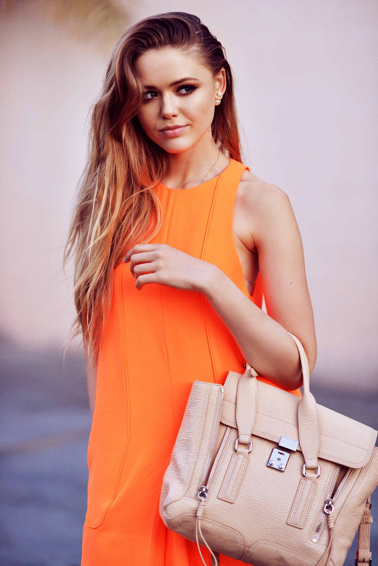 Kristina Bazan is wearing a Neon dress from Finders Keepers, and the bag is from Philip Lim