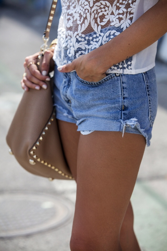 Alexandra Pereira is wearing a lace top from CLP, shorts from MiH and the bag is from Valentino
