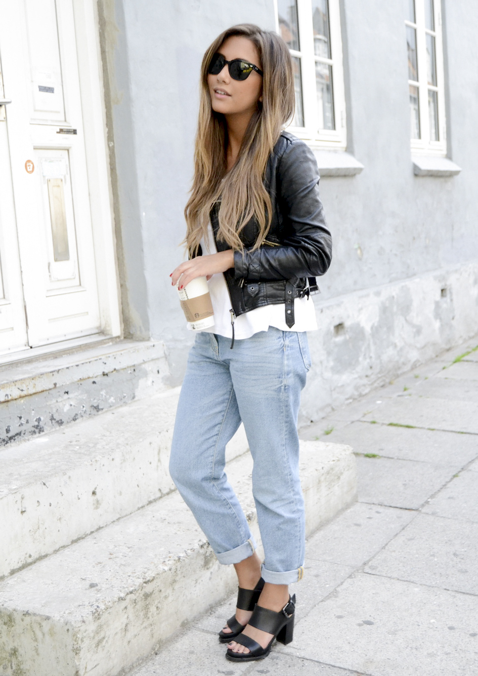 Michelle Nielsen is wearing boyfriend jeans from Zara, leather jacket from TopShop, peplum top and the shoes are from & Other Stories
