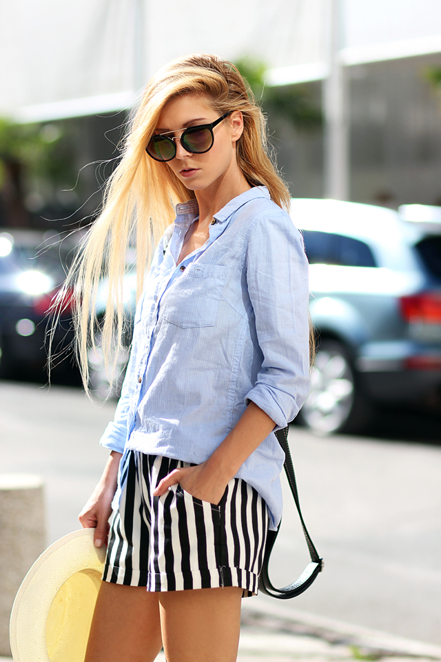 Sirma Markova is wearing a sky blue shirt from House, striped shorts from Choies, hat from Parfois and sunglasses from Stradivarius