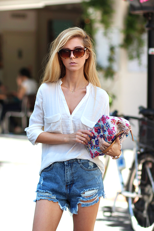 Sirma Markova is wearing denim shorts from Lovely Wholesale, shirt from Zara, bag from Parfois, and sunglasses from Tally