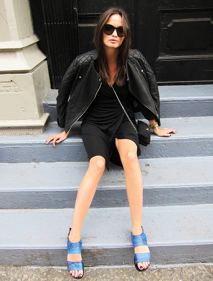 Columbine Smile is wearing sandals from ATP Atelier, bag from Chanel, sunglasses from Prada and leather jacket from H&M