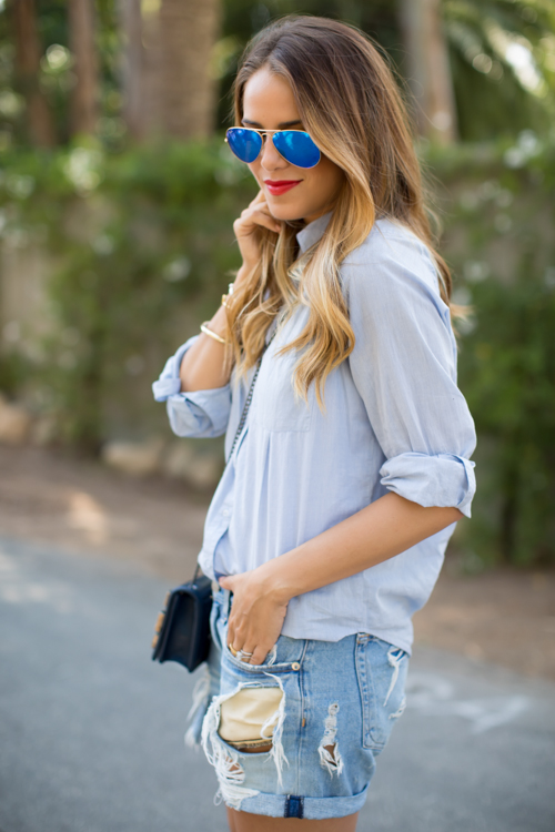 Julia Engel is wearing a chambray from Joie, denim shorts from Rag & Bone and aviators from Rayban