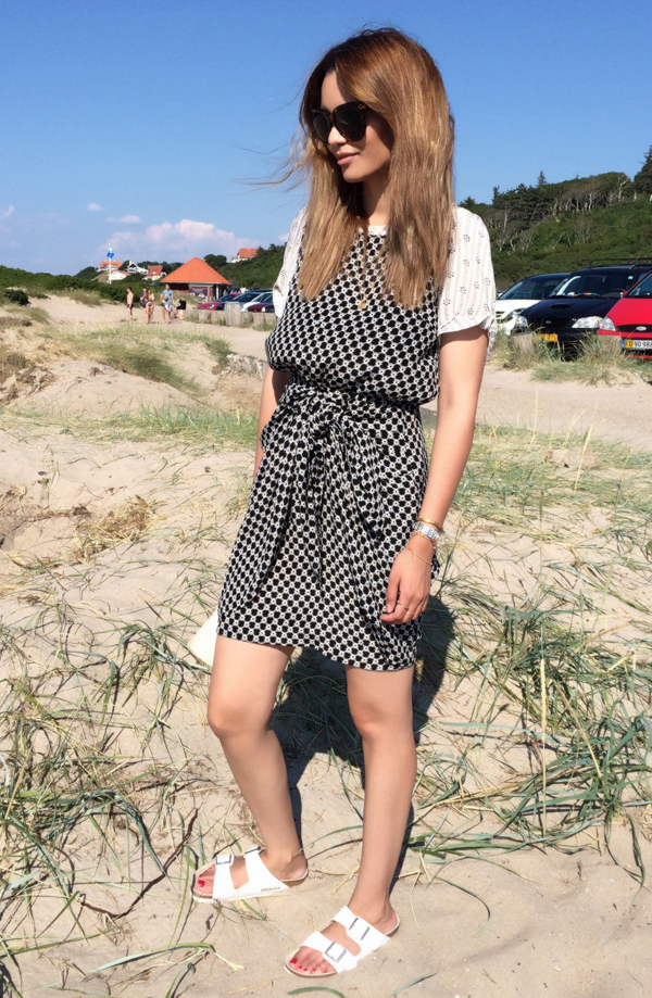 Funda Christophersen is wearing a black and white chequered dress from Isabel Marant, sandals from Birkenstock and sunglasses from Celine