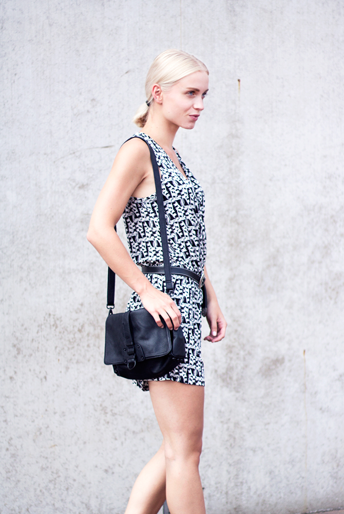 Anita VDH is wearing a black and white printed dress from Boohoo and the bag is from H&M