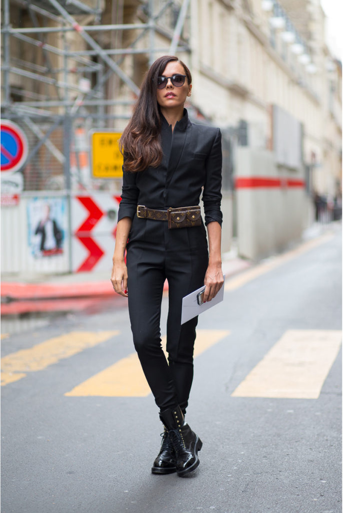 Evangelie Smyrniotaki is wearing a black jumpsuit from Saint Laurent, boots from Chanel, sunglasses from Rayban