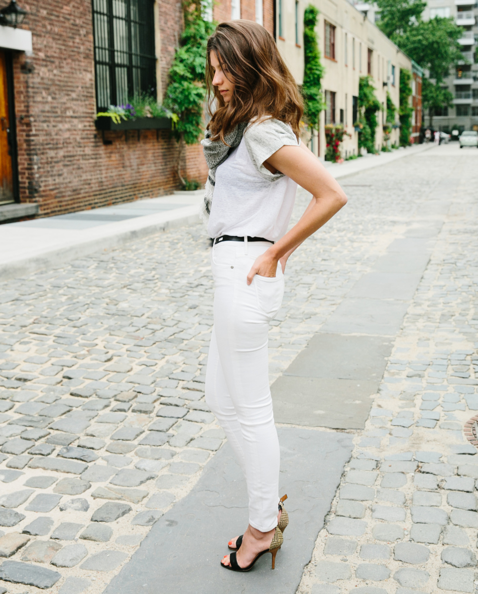 Marie is wearing pure white skinny jeans, white linen T-shirt and shoes all from Madewell