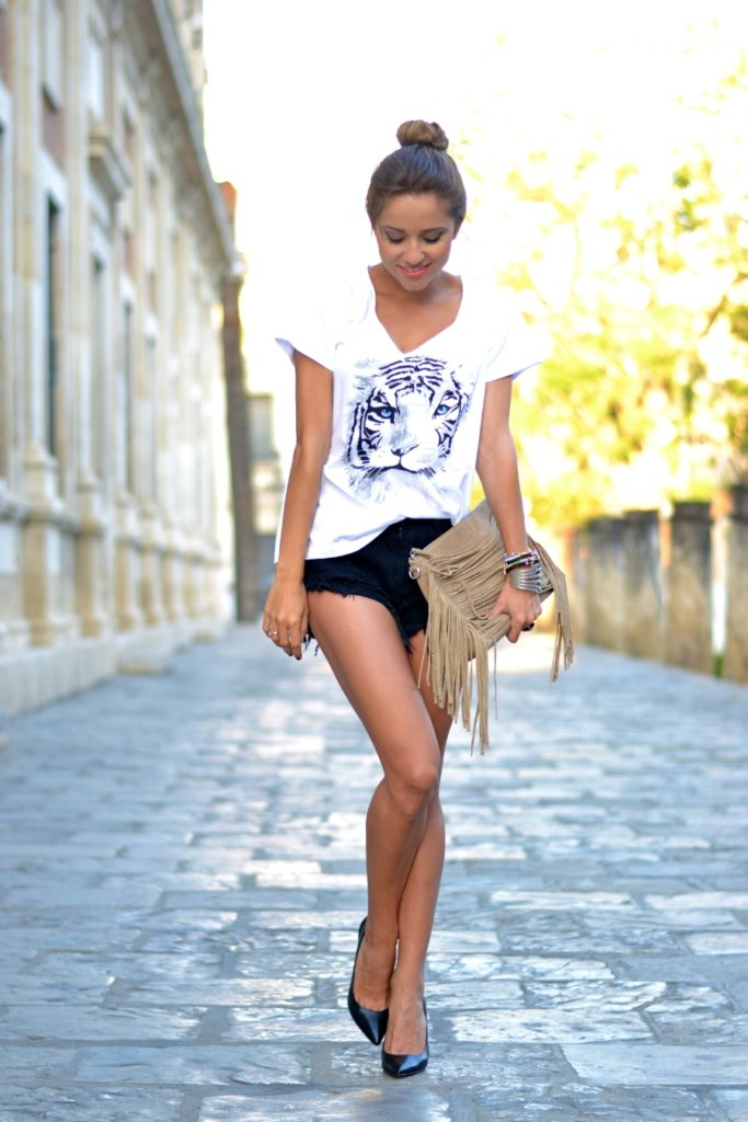 Just Coco is wearing a tiger print top from You Natura, shorts from Sheinside, bag from Parfois, and shoes from Guess