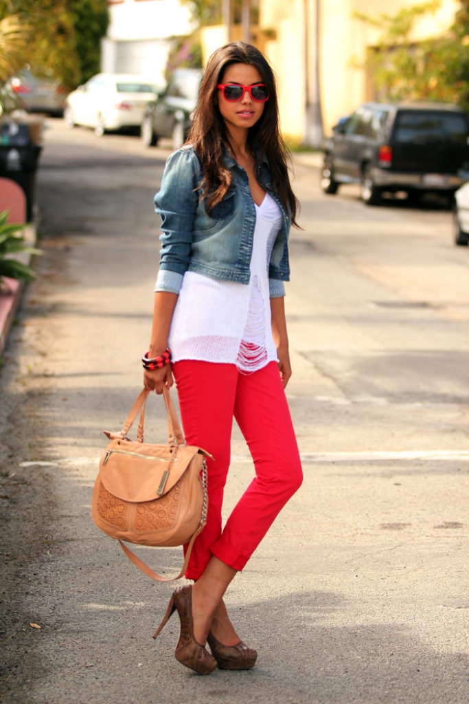 Annabelle Fleur is wearing red jeans from J Brand, denim jacket from Guess, jumper from POL, bag from Botkier Lobos