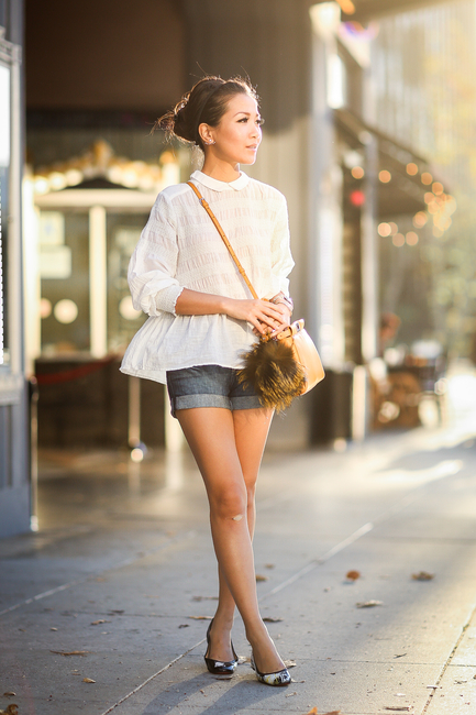 Wendy Nguyen is wearing a white top from Free People, denim shorts from AG Adriano Goldschmied, bag from Fendi, and the shoes are from Christian Louboutin