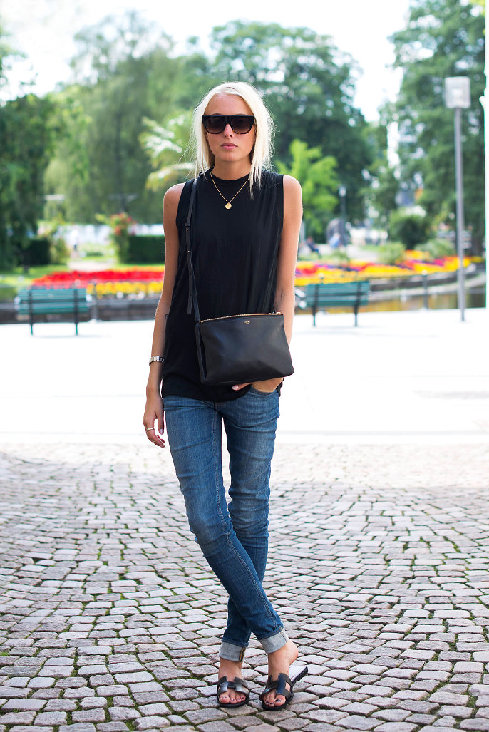 Ellen Claesson is wearing Jeans and black top from Acne, sandals from Hermés and the bag and sunglasses are from Céline