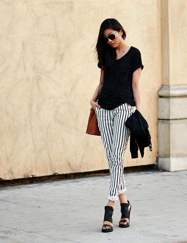 Angela L is wearing shoes from Jeffrey Campbell, striped pants from Forever21 and the sunglasses are from Karen Walker