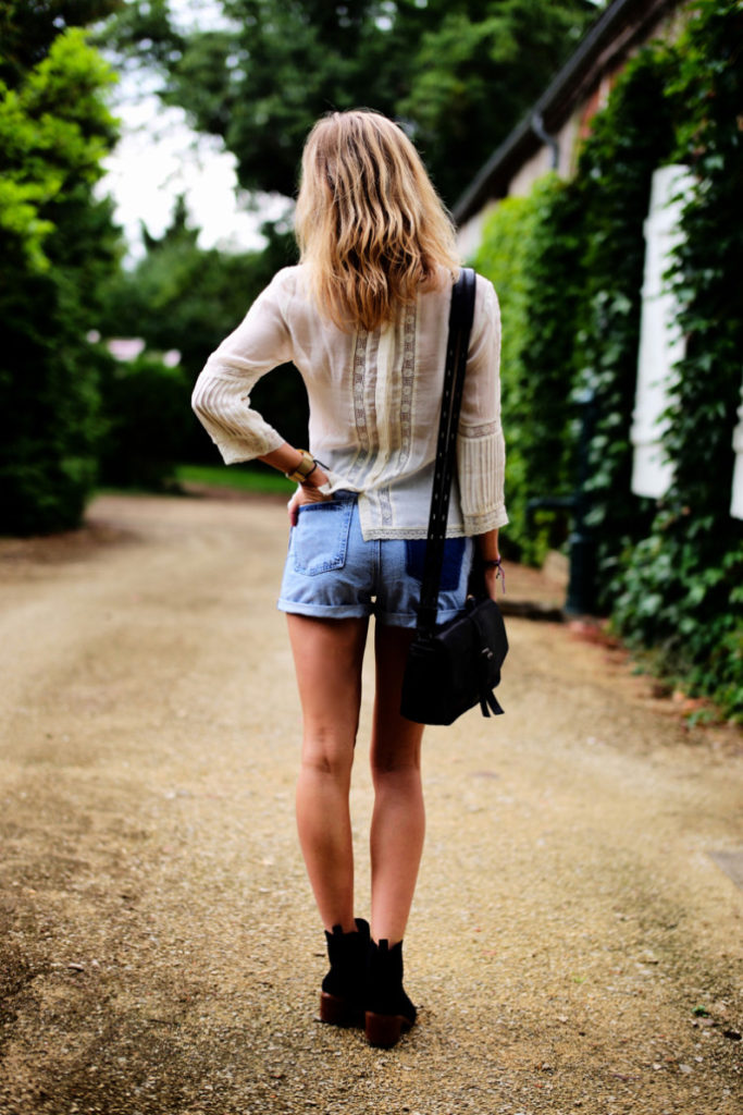 Lucy Williams is wearing a top, shorts, shoes and bag. All from TopShop