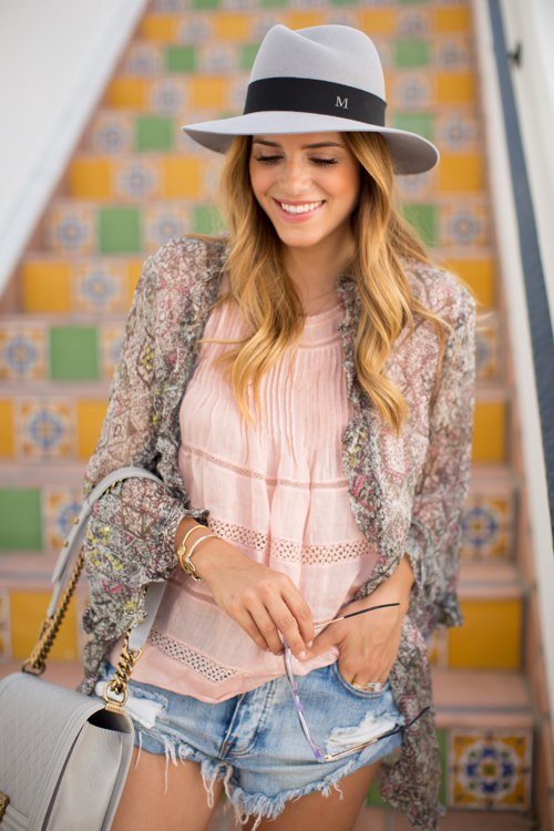Julia Engel is wearing a kimono from Kite & Butterfly, pink top from Isabel Marant, shorts from One Teaspoonhat from Maison Michel and a Chanel bag