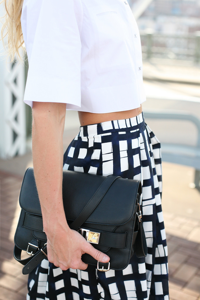 Mary Seng is wearing a a white shirt from Alexander Wang, skirt from ASOS and the bag is from Proenza Schouler