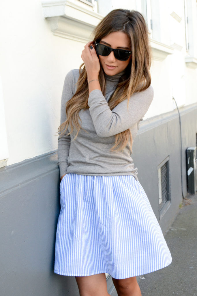 Michelle Nielsen is wearing a grey turtleneck from Front Row, and striped skirt from Monki
