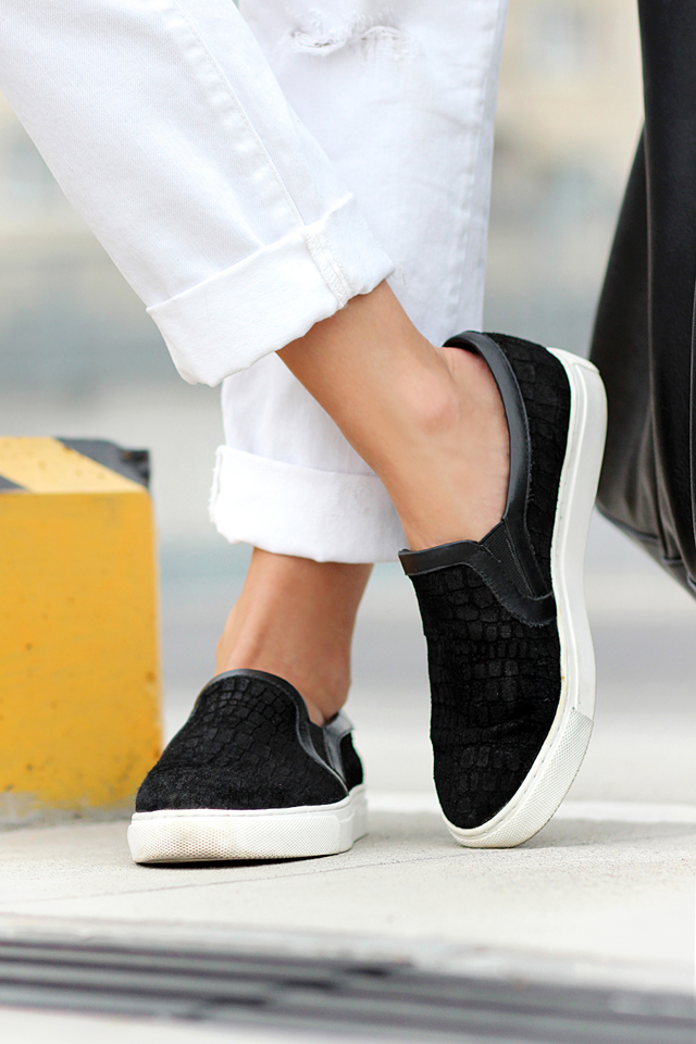 Sirma Markova is wearing black textured slip-on sneakers from Choies