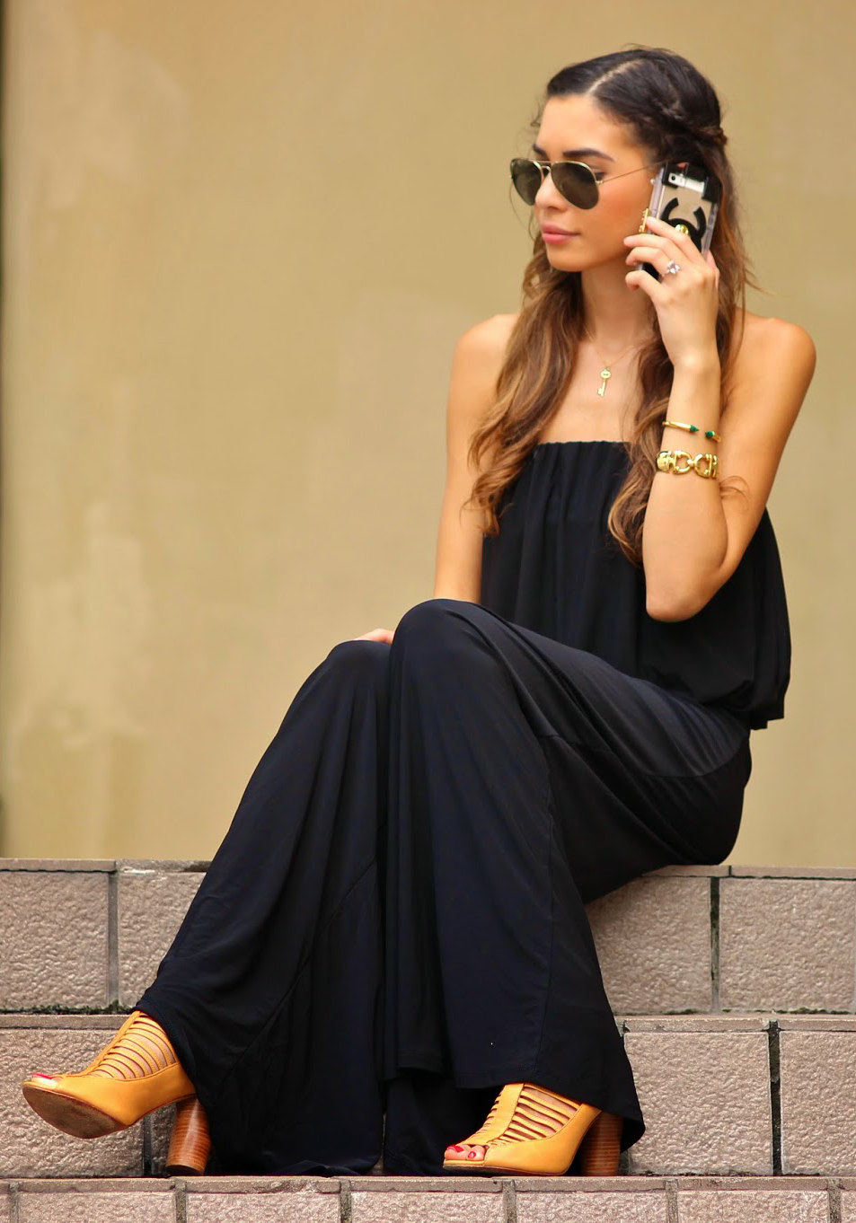 Jasmine Tosh is wearing a black jumpsuit from Blush Boutique