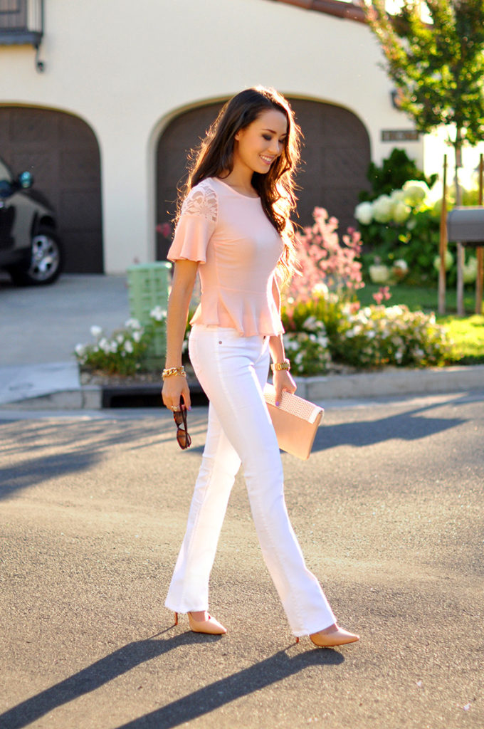 Jessica R is wearing pink top from Lulu's, white jeans from Abercrombie, shoes from Schutz and clutch from Michael Kors