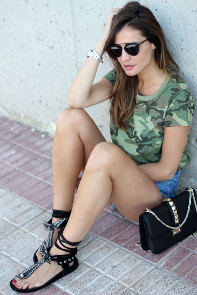 Silvia Zamora is wearing a camo T-shirt from, Abicyclette, denim shorts from Zara, studded sandals from Isabel Marant, bag from Valentino and sunglasses from Dior