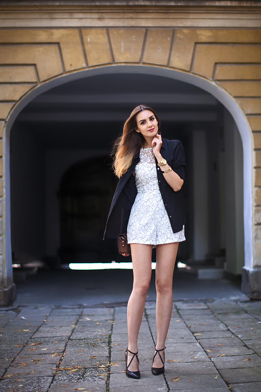 Nika Huk is wearing a crackle paint crackle paint playsuit from AX Paris, black paint by StyleMint and shoes from Zara
