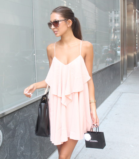 Felicia Akerstrom is wearing a peach dress from NLY, sunglasses from River Island and a bag from Marc Jacobs