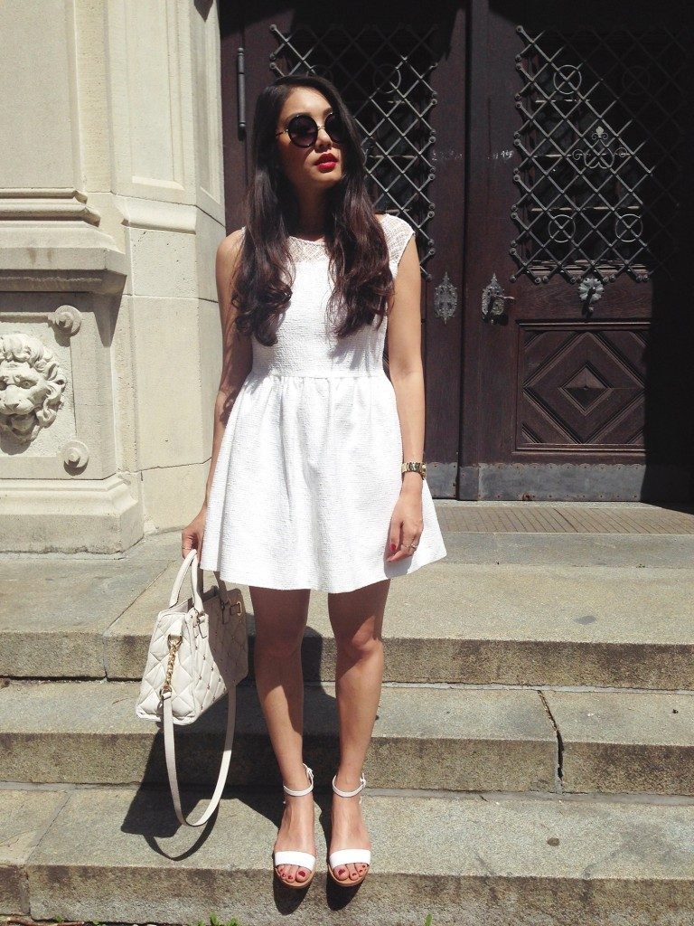 Thao Nhi Le is wearing a white summer dress
