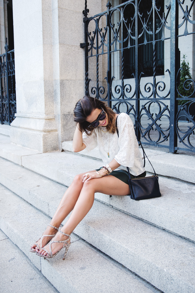 Sara Escudero is wearing top, skirt and snake print shoes from Zara, and the bag is from Celine