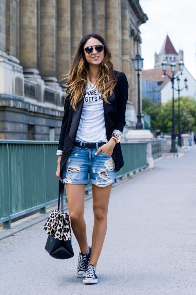 Soraya Bakhtiar is wearing a distressed shorts from Rag & Bone, black blazer from Isabel Marant, bag from Celine, tee from CHRLDR and sneakers from Converse